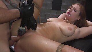 Skylar Snow is bound with rope while her pussy is over-stimulated