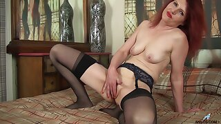 Redhead mature Cee Cee takes off her rags to masturbate