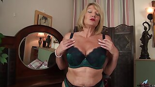 Solo mature Amy Goodhead in stockings and underclothing effectuation on the bed