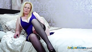 Blonde mature lady stripping down and playing alone with toy Find this video on our network Oldnanny.com