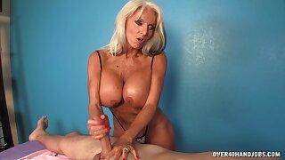This mature woman gives him a handjob!